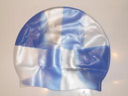 Bonnet de bain en silicone. Source : http://data.abuledu.org/URI/50fc869a-bonnet-de-bain-en-silicone