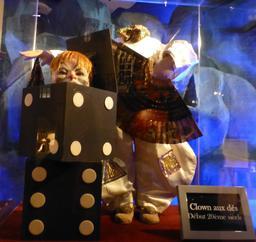 Clown aux dés au musée des automates. Source : http://data.abuledu.org/URI/5822201c-clown-aux-des-au-musee-des-automates