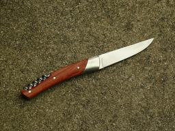 Couteau tire-bouchon droite. Source : http://data.abuledu.org/URI/5458f7e4-couteau-tire-bouchon-droite