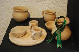 Dinette en terre cuite mexicaine. Source : http://data.abuledu.org/URI/52c9debb-dinette-en-terre-cuite-mexicaine