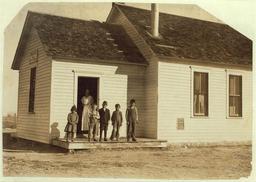 Élèves d'une école américaine en 1915. Source : http://data.abuledu.org/URI/5262961e-eleves-d-une-ecole-americaine-en-1915