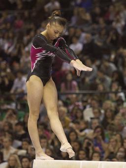 Gymnaste italienne à la barre fixe. Source : http://data.abuledu.org/URI/54735a6c-gymnaste-italienne-a-la-barre-fixe