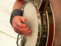 Joueur de banjo. Source : http://data.abuledu.org/URI/5654a337-joueur-de-banjo