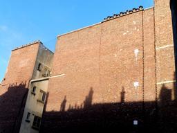 Murs de briques parisiens. Source : http://data.abuledu.org/URI/592f76d3-murs-de-briques-parisiens