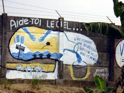 Peinture sur palissade à Douala. Source : http://data.abuledu.org/URI/52dac4a4-peinture-sur-palissade-a-douala