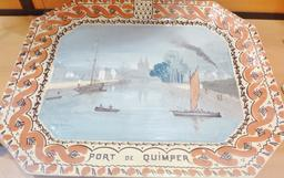 Plat en faïence de Locmaria du Port de Quimper. Source : http://data.abuledu.org/URI/58586357-plat-en-faience-de-locmaria-du-port-de-quimper