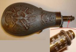 Poire à poudre à fusil. Source : http://data.abuledu.org/URI/52170814-poire-a-poudre-a-fusil