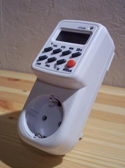 Prise de courant avec minuterie. Source : http://data.abuledu.org/URI/524c2f82-prise-de-courant-avec-minuterie