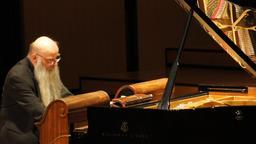 Rex Lawson au pianola. Source : http://data.abuledu.org/URI/53b54cfe-rex-lawson-au-pianola