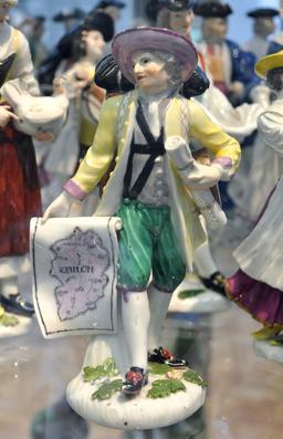 Statuette de marchand de cartes. Source : http://data.abuledu.org/URI/50eb393b-statuette-de-marchand-de-cartes