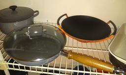 Ustensiles de cuisine en fonte émaillée. Source : http://data.abuledu.org/URI/511e832d-ustensiles-de-cuisine-en-fonte-emaillee