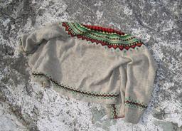 Veste d'enfant en laine. Source : http://data.abuledu.org/URI/50fbb476-veste-d-enfant-en-laine