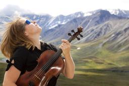 Violoniste en concert dans le parc Denali. Source : http://data.abuledu.org/URI/59dd634d-violoniste-en-concert-dans-le-parc-denali