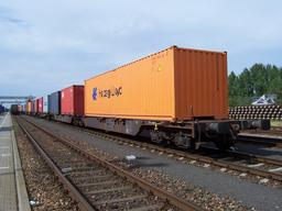 Wagons porte-containers. Source : http://data.abuledu.org/URI/53610d11-wagons-porte-containers