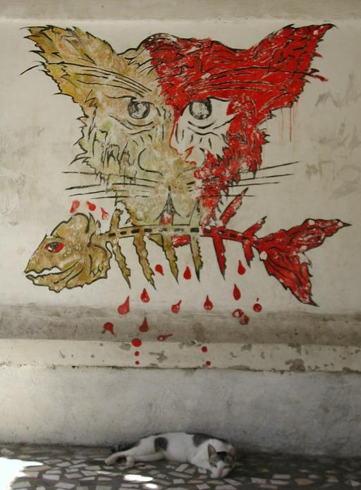 Chats et poisson