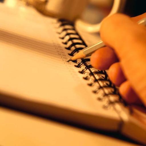 Écrire sur carnet à spirales