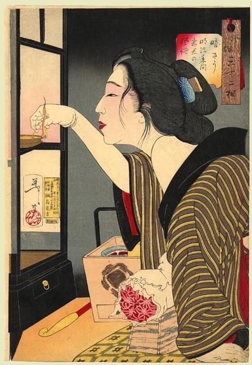 Japonaise le soir allumant sa lampe à huile