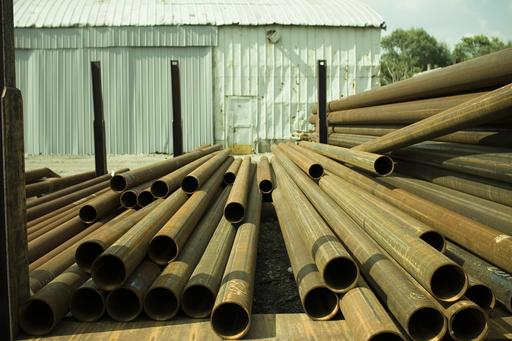 Metal tubes stored in a yard.jpg