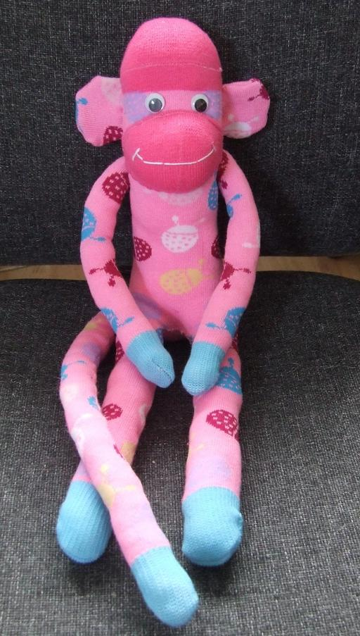 Poupée singe en rose