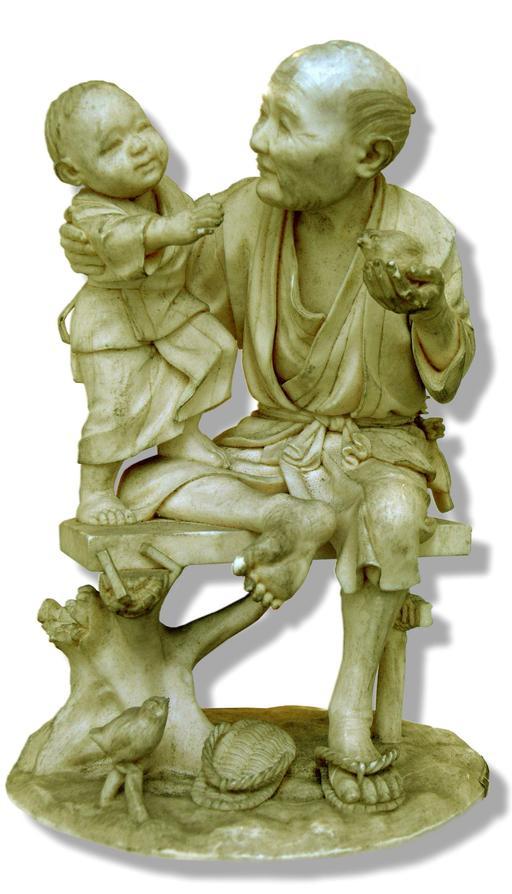 Statuette d'un homme jouant avec un enfant